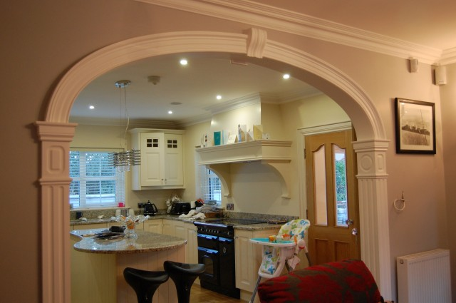 Room dividing arch on columns gallagher mouldings for Designs of arches in living room